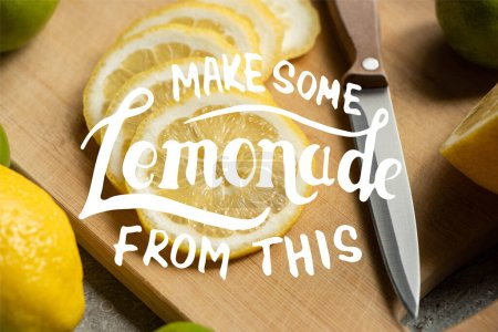 Photo for Close up view of sliced lemon on wooden cutting board with knife, make some lemonade from this illustration - Royalty Free Image