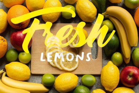 top view of tasty colorful fruits and wooden cutting board with lemon slices, fresh lemons illustration