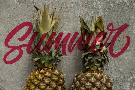 Photo for Top view of ripe pineapples on grey concrete surface, summer illustration - Royalty Free Image