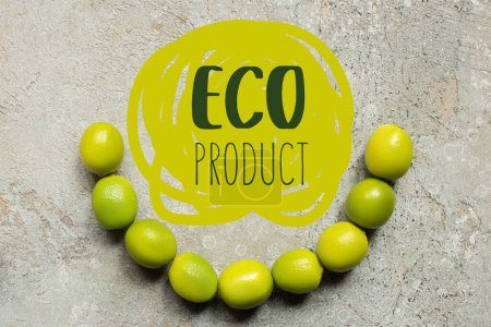top view of green limes on grey concrete surface, eco product illustration