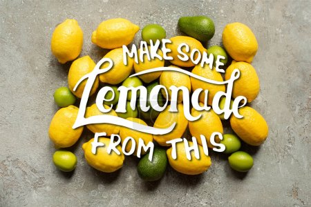 top view of colorful avocado, limes and lemons on grey concrete surface, make some lemonade from this illustration