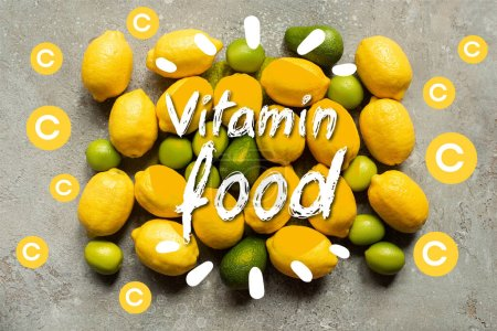 top view of colorful avocado, limes and lemons on grey concrete surface, vitamin food illustration