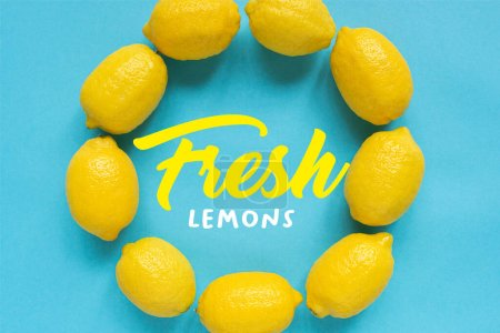 Photo for Top view of ripe yellow lemons arranged in round frame with fresh lemons illustration on blue background - Royalty Free Image