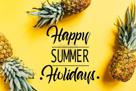 Photo for Top view of fresh tasty pineapples on yellow background with happy summer holidays illustration - Royalty Free Image