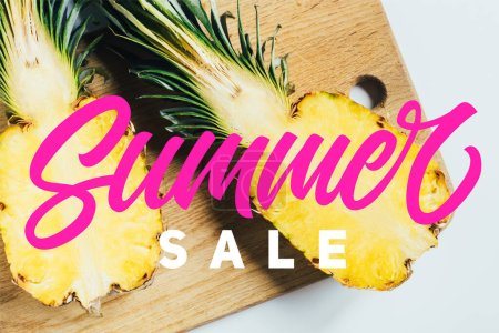top view of juicy pineapple halves on wooden cutting board on white background with summer sale illustration