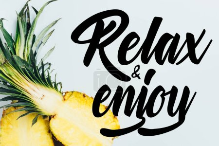 Photo for Top view of juicy pineapple halves on white background with relax and enjoy illustration - Royalty Free Image