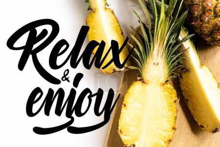 Photo for Top view of cut juicy pineapple on cutting board on white background with relax and enjoy illustration - Royalty Free Image