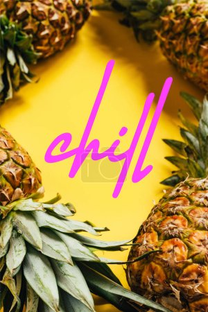Photo for Selective focus of fresh ripe pineapples with green leaves on yellow background with chill illustration - Royalty Free Image