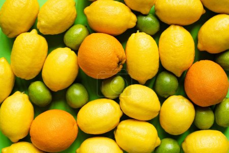 top view of fresh ripe lemons, oranges and limes