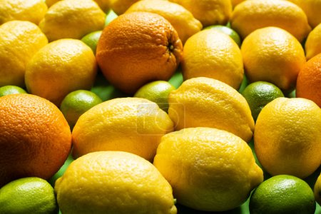 close up view of fresh ripe lemons, oranges and limes