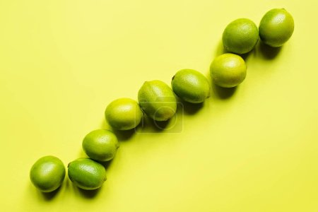 Photo for Top view of ripe limes on colorful background - Royalty Free Image