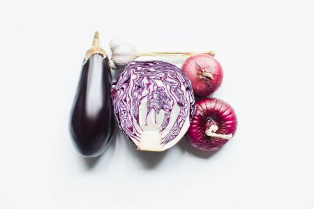 Photo for Top view of red onion, red cabbage, eggplant and garlic on white background - Royalty Free Image