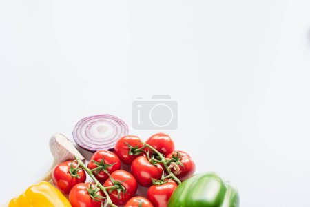 tomatoes, garlic, red onion, bell peppers isolated on white