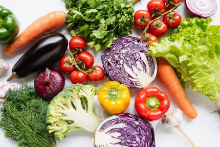 Photo for Top view of assorted fresh vegetables on white background - Royalty Free Image