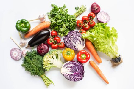 top view of colorful assorted fresh vegetables on white background