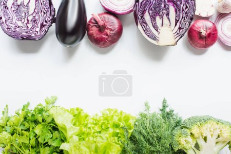 Photo for Top view of purple and green vegetables on white background - Royalty Free Image
