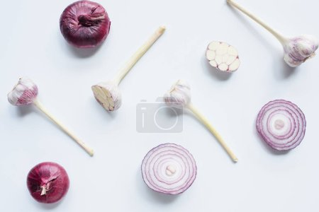 Photo for Top view of scattered red onion and garlic on white background - Royalty Free Image