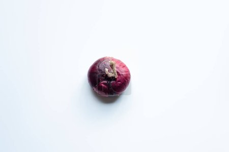 top view of purple whole red onion on white background