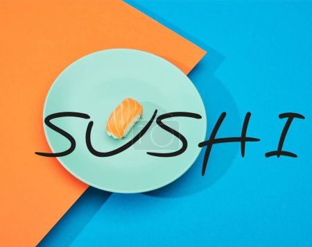 Photo for Fresh nigiri with salmon near sushi lettering on blue and orange surface - Royalty Free Image