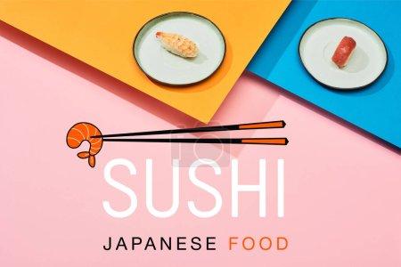 Photo for Fresh nigiri with tuna and shrimp near chopsticks illustration and sushi japanese food lettering on blue, pink, orange surface - Royalty Free Image