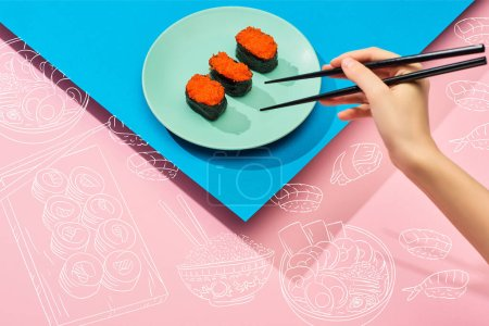 Photo for Cropped view of woman holding chopsticks near nigiri with red caviar and sushi illustration on blue, pink background - Royalty Free Image