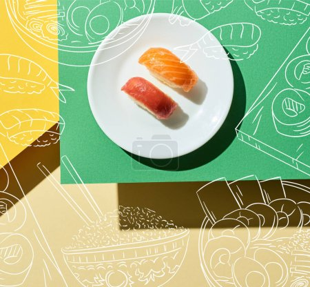 Photo for Top view of fresh nigiri with salmon and tuna near japanese food illustration on green and yellow surface - Royalty Free Image