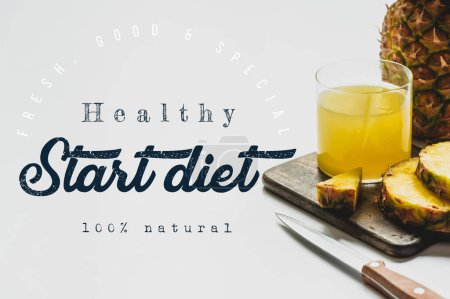 Photo for Pineapple juice in glass near delicious fruit on cutting board with knife and healthy, start diet lettering on white - Royalty Free Image