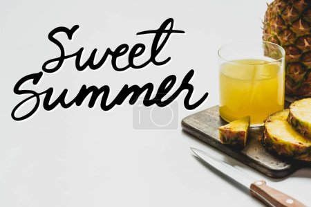 Photo for Pineapple juice in glass near delicious fruit on cutting board and sweet summer lettering on white - Royalty Free Image