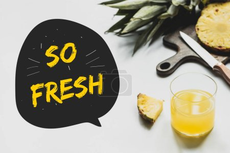 Photo for Delicious pineapples on wooden cutting board with knife near glass of orange juice and so fresh lettering on white - Royalty Free Image