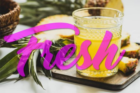 Photo for Selective focus of pineapple juice in glass near delicious fruit on cutting board and fresh lettering on white - Royalty Free Image