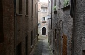 Close dark alley in Urbino  Italy