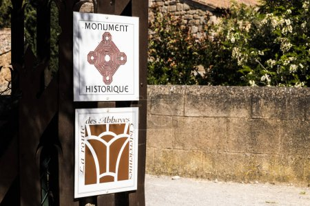 Narbonne, France. Signs with the logos of Monument Historique (Historical Monument) and La Route des Abbayes Cisterciennes (Cistercian abbeys). Abbaye de Fontfroide, France