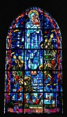 Stained glass window in the church of Sainte-Mere-Eglise, Normandy, France, depicting the landing of the paratroopers during the D-Day Normandy Landings in World War II