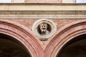The face of the devil in one of the palaces of Piazza Santo Stefano, called L inferno a casa