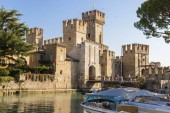 The Castello Scaligero or Scaliger castle, a 13th century medieval port fortification near Lago di Garda in Sirmione, Lombardy, northern Italy