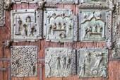 The bronze door of the Basilica di San Zeno Maggiore in Verona, Italy, decorated with 48 square panels made in the 11th century