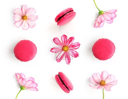 Photo for Creative layout made of pink flowers and macaroons isolated on white background. Flat lay. Food concept. - Royalty Free Image