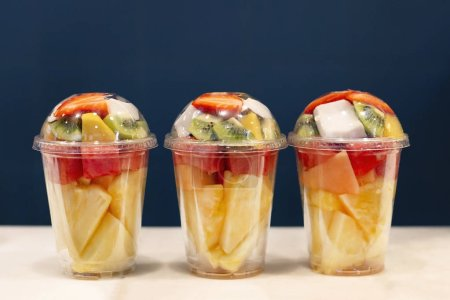 Three mixed fruit vitamin salad in the plastic gla...