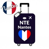 Luggage with airport station code IATA or location identifier and destination city name Nantes NTE Travel to France Europe concept Heart shaped flag of the France on baggage