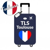 Luggage with airport station code IATA or location identifier and destination city name Toulouse TLS Travel to France Europe concept Heart shaped flag of the France on baggage