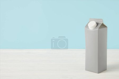 Photo for Closeup view of milk in blank carton package on white surface - Royalty Free Image