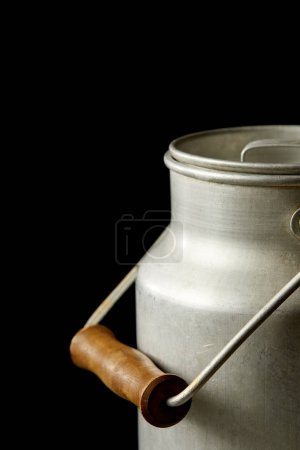 closeup view of milk in aluminium can isolated on black background