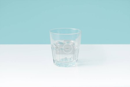 Photo for Closeup view of water in glass on blue background - Royalty Free Image