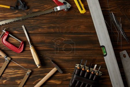elevated view of different tools on brown wooden tabletop