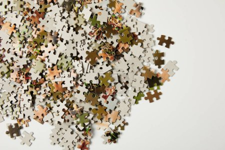 top view of jigsaw puzzle pieces with copy space on grey