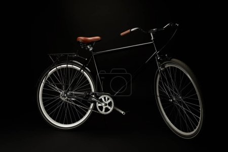 side view of comfortable vintage bicycle isolated on black