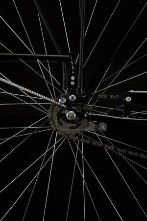 detail of bicycle wheel isolated on black, close-up view
