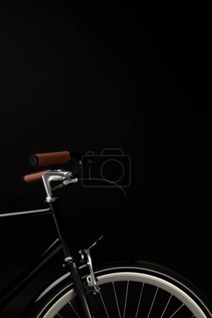 Photo for Handlebars and wheel of vintage bicycle isolated on black - Royalty Free Image