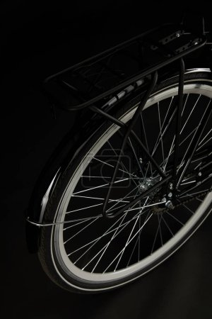 Photo for Close-up view of wheel of classic bicycle isolated on black - Royalty Free Image