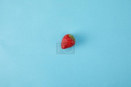 Photo for Top view of ripe strawberry isolated on blue - Royalty Free Image